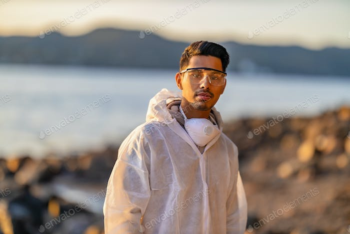 Confident male scientist or health worker standing at beach