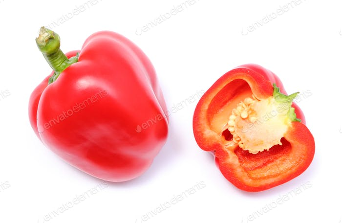 Whole and half of fresh peppers on white background