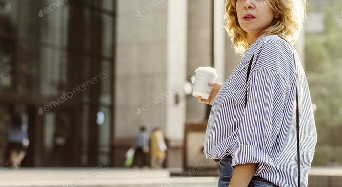 Closeup of woman with take away coffee