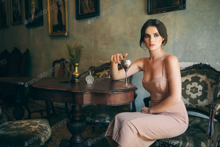 attractive seductive sensual stylish woman in boho dress sitting vintage retro cafe