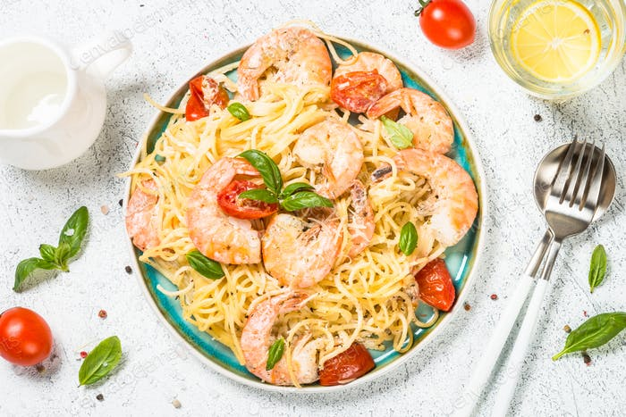 Pasta seafood with shrimp on white table
