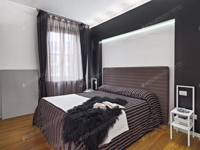 Interiors of the Modern Bedroom with Wooden Floor
