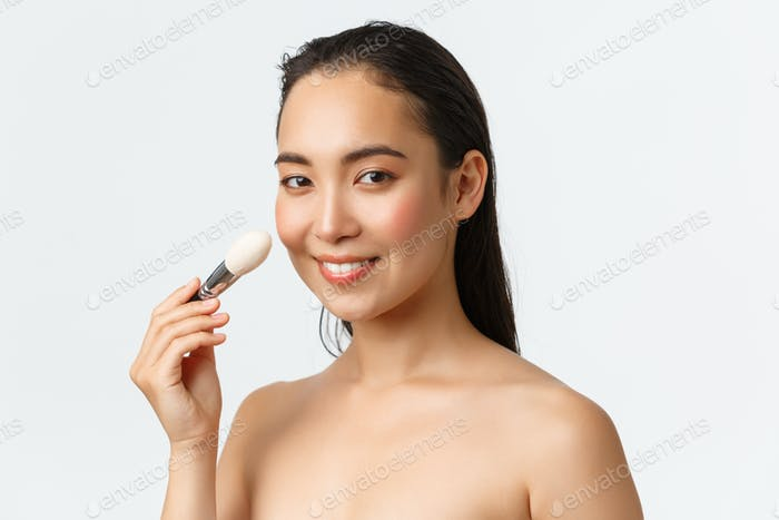 Skincare, women beauty, hygiene and personal care concept. Close-up of beautiful asian woman