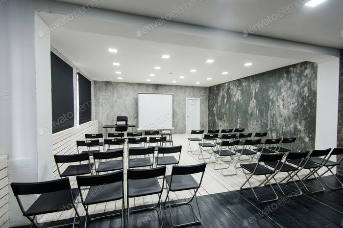 Modern university group study room with white desk and chairs