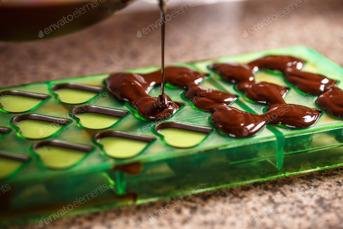 Putting chocolate in mold