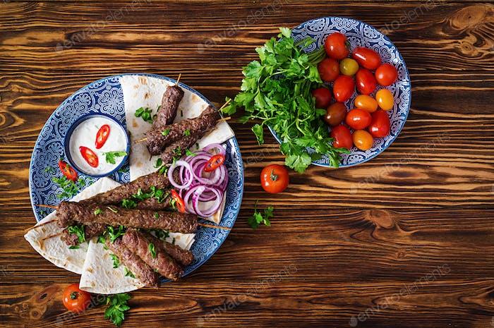 Kebab adana, chicken, lamb and beef on lavash bread