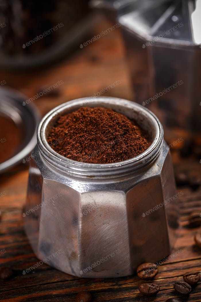 Old coffee maker filled with ground coffee