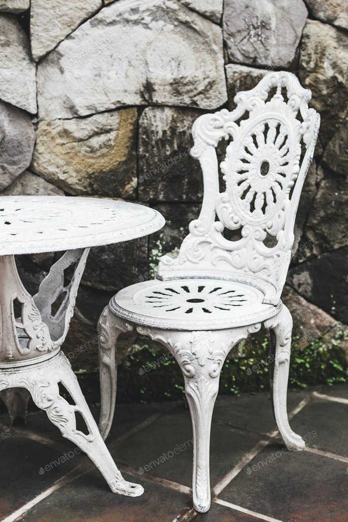 Old vintage white furniture outside in cafe, handmade, carved, french style