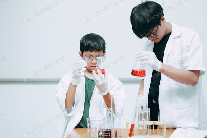 Asian Science Student and Young Teacher