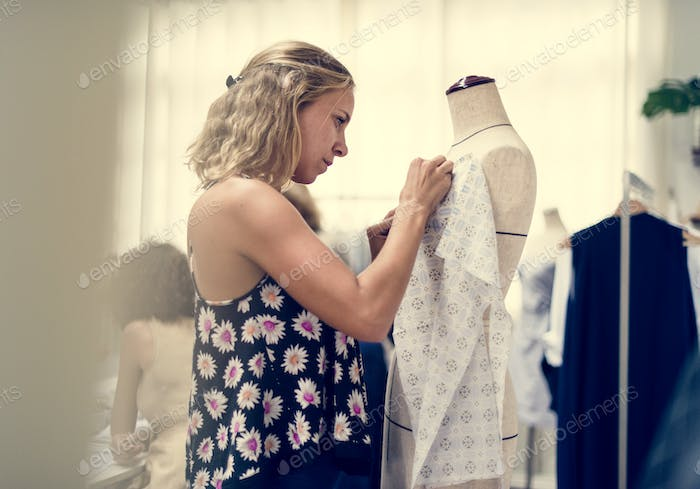 Customer checking out clothing shop