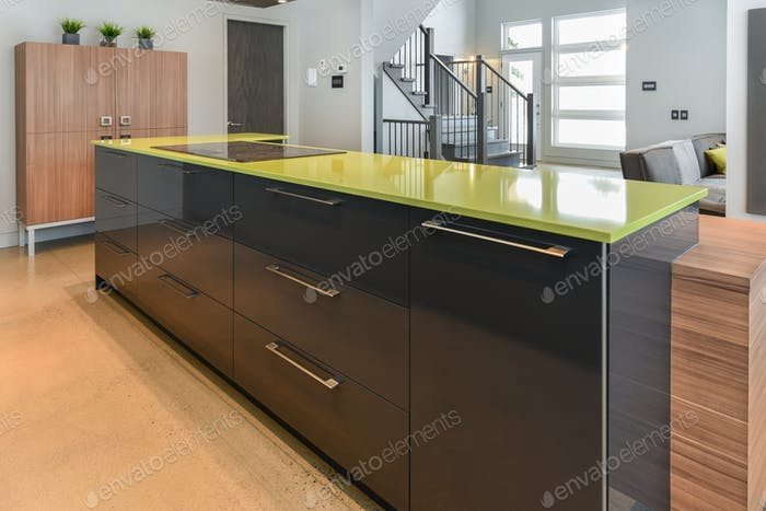 Modern kitchen with green quartz island close-up