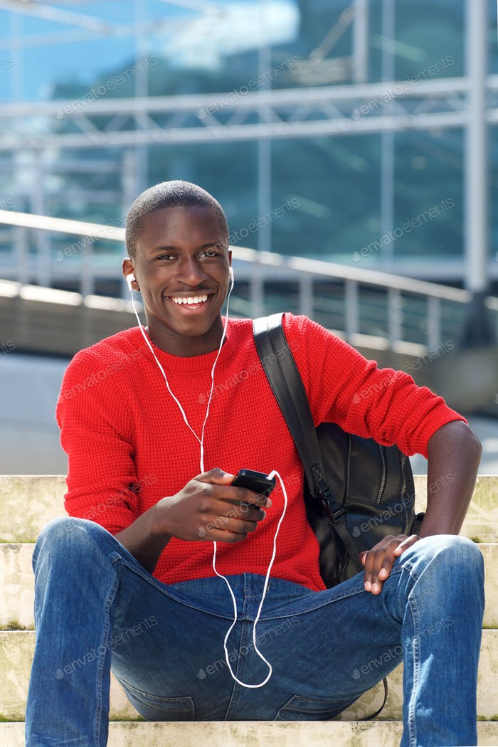 Young handsome african man with mobile phone