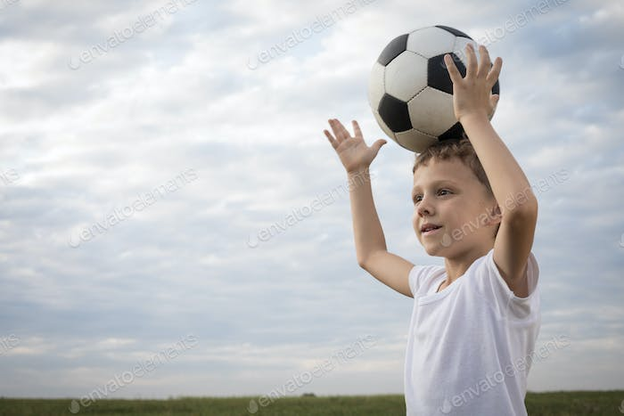 Portrait of a young  boy with soccer ball.
