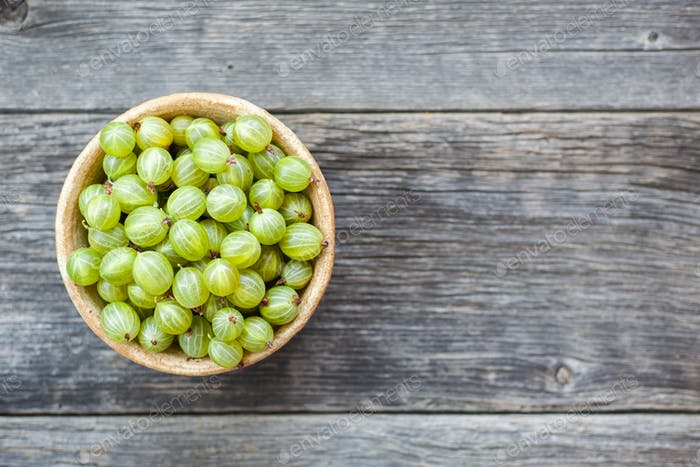 Gooseberries fruits on wooden background