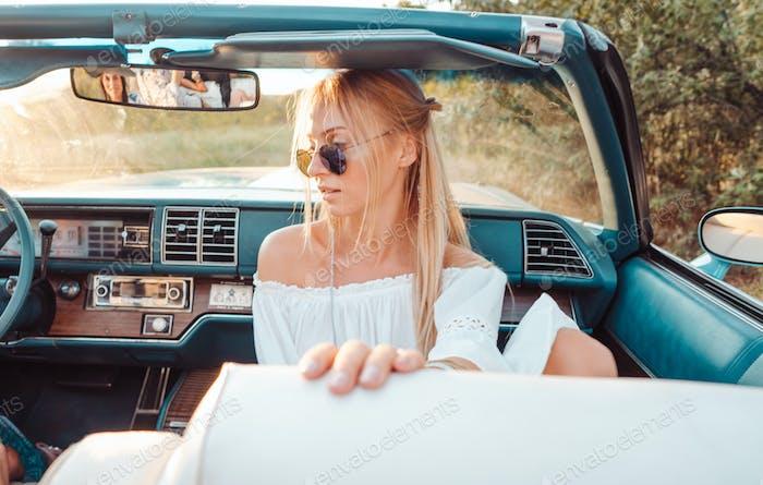 Girl posing in a convertible
