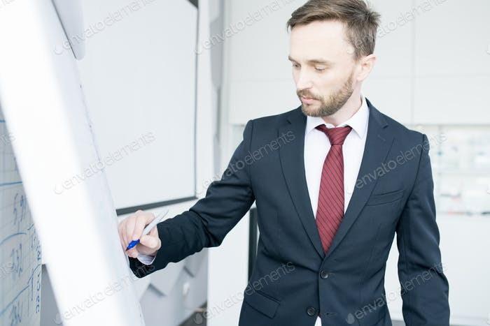 Handsome Businessman at Whiteboard