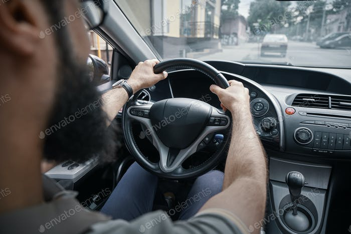 Man driving and watching the road