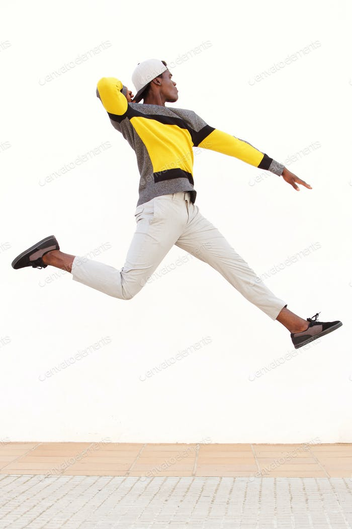 cool young african man jumping in air