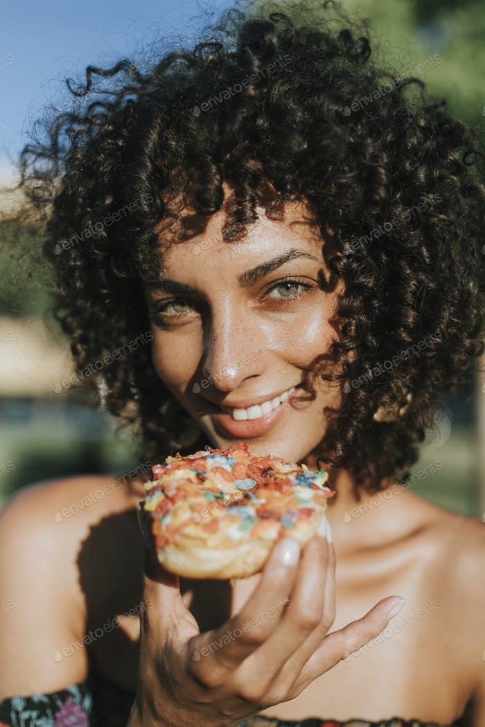 Beautiful woman eating a doughnut