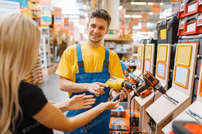Consultant and female consumer in hardware store
