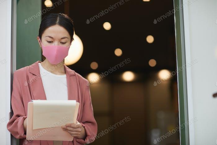 Businesswoman working during epidemic
