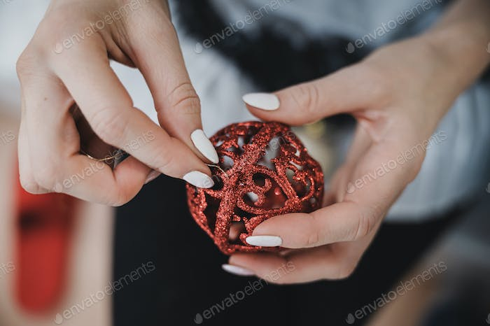 Attaching golden string to Christmas ornament
