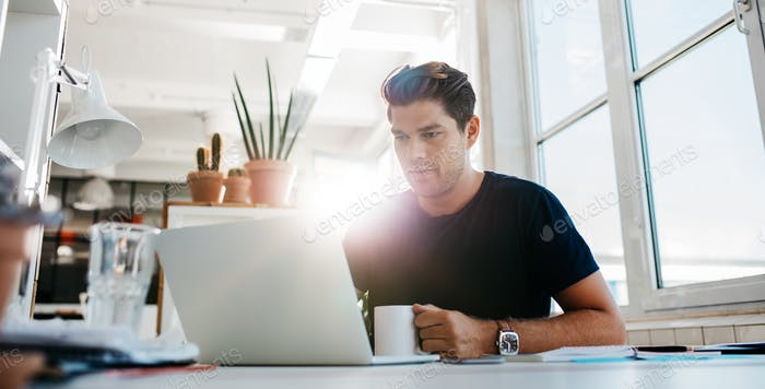 Young businessman working on laptop computer