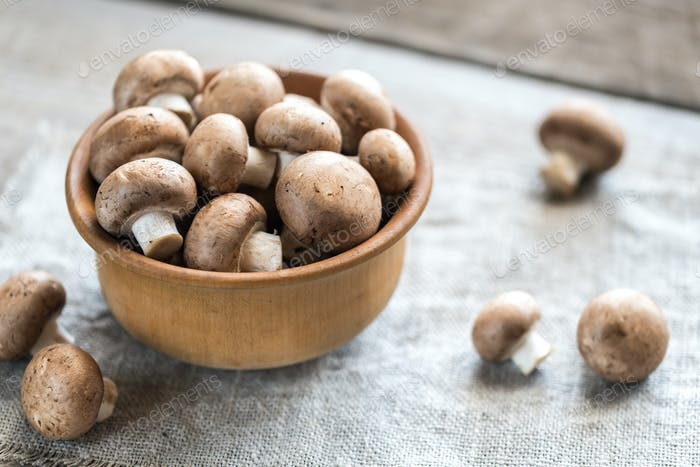 Bowl of brown champignon mushrooms