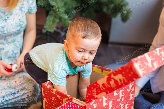Young Baby Boy Opening a Gift Box