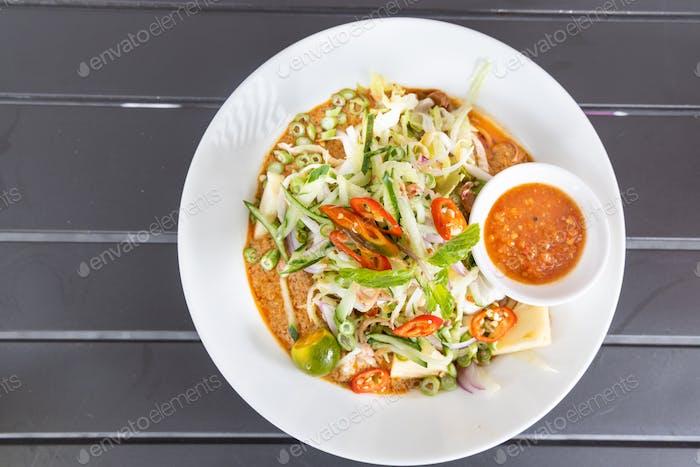 Laksa Johor, popular Malay noodle with ulam and sambal belacan