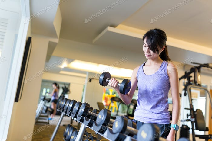 Woman working out on dumbbell
