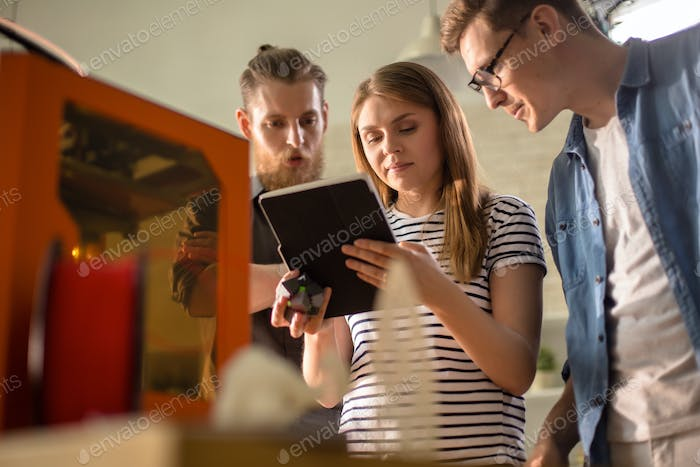 Young People Working with Modern Technology
