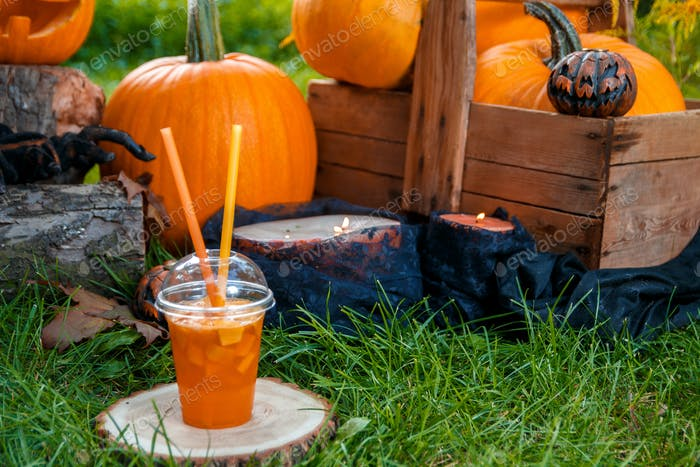 Thumbnail for Halloween cocktail with pumpkins decoration on background. Punch for a party. Jack-o-Lantern.