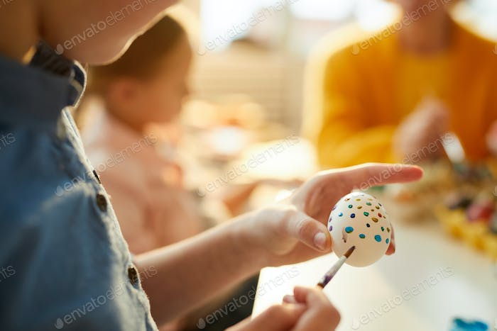 Child Painting Eggs for Easter Closeup