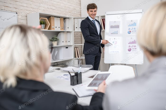 Young Man Presenting Project in Office
