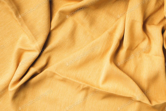 Yellow fabric texture background. Top View of cloth textile surface. Abstract backdrop for design