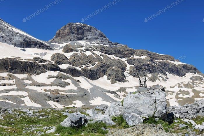 Monte Perdido Peak and Marbore cylinder from Marbore Iced lake in Ordesa national Park, Spain