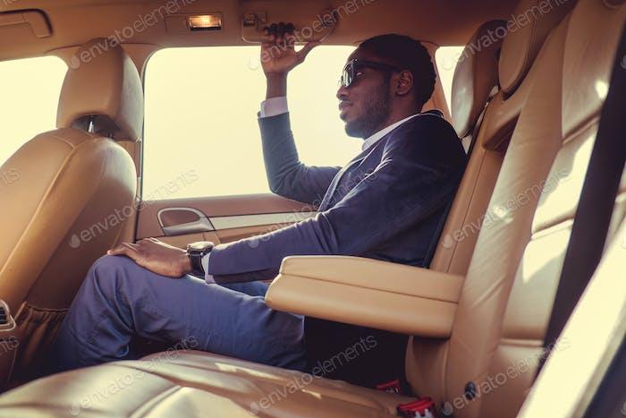A black man in the car.