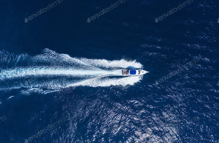 Yachts at the sea in Bali, Indonesia. Aerial view of luxury floating boat.
