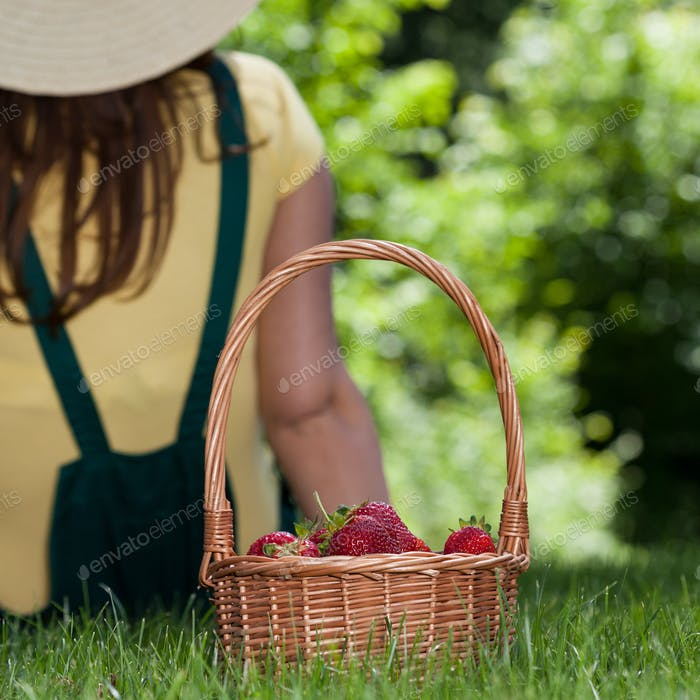 Woman with basket of strawberries