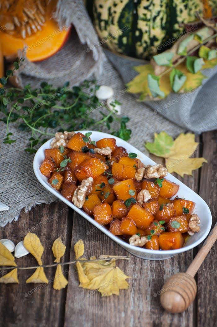 Baked pieces of pumpkin with honey, walnuts and thyme.