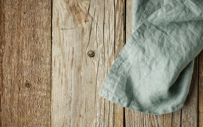 linen napkin on wooden background