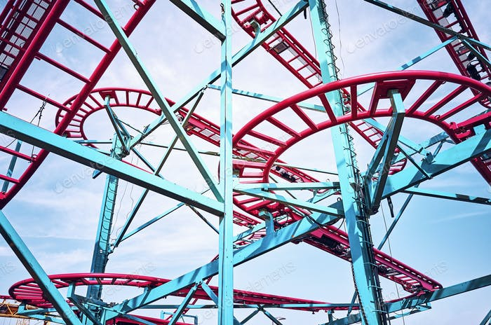 Roller coaster tracks in an amusement park.