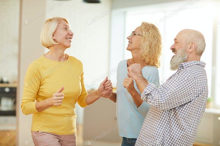 Active seniors dancing boogie-woogie