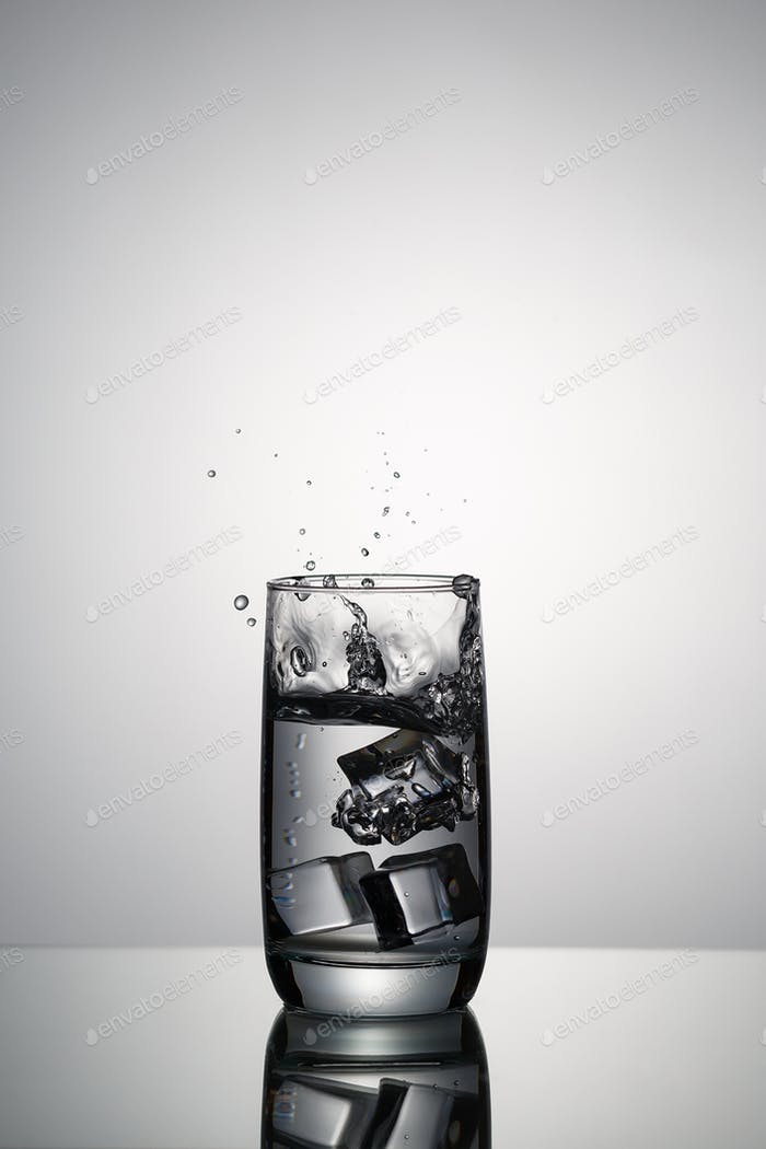 Glass of clean water with ice