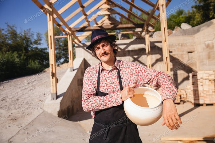 Potter master on pottery yard.