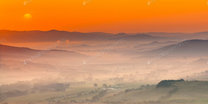 Tuscany orange foggy landscape scene
