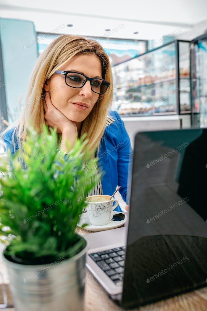 Woman working with the laptop