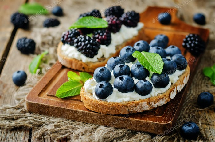 Blueberry and blackberry ricotta rye sandwiches