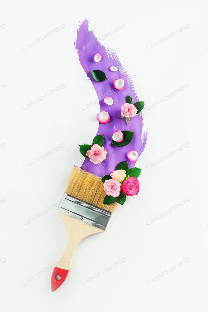 Violet paint with a paintbrush and flower arrangement on white background. Painting spring creative